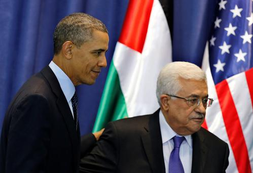 U.S. President Barack Obama (L) and Palestinian President Mahmoud Abbas leave after a joint news conference at the Muqata presidential compound in Ramallah