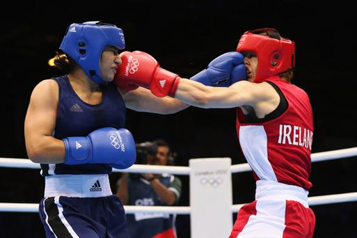 Katie Taylor in action against Mavzuna Chorieva of Tajikistan during the Women's Light (60kg) Boxing semifinals of the London 2012 Olympic Games