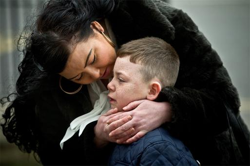 Peter Comerford's granddaughter, Charlene, and greatgrandson, Christian, at his funeral in St Agnes's Church, Crumlin, Dublin