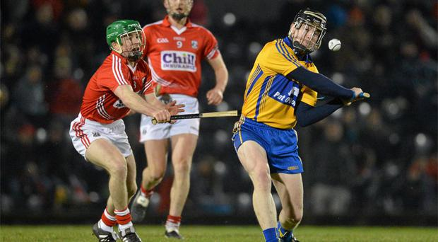 Clare's Tony Kelly attempts to escape the attentions of Daniel Kearney of Cork during last weekend's Allianz NHL clash in Pairc Ui Rinn