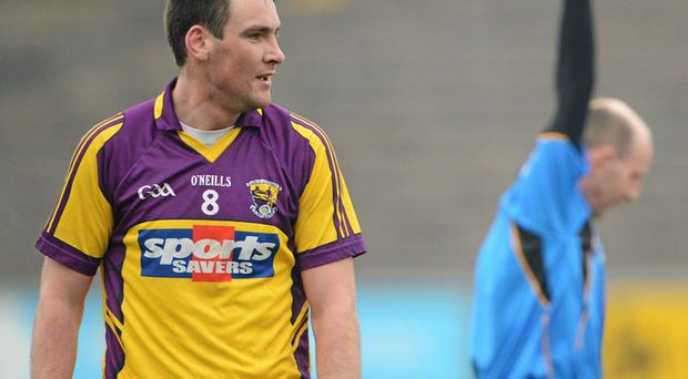 Daithi Waters is shown the red card by referee Michael Collins