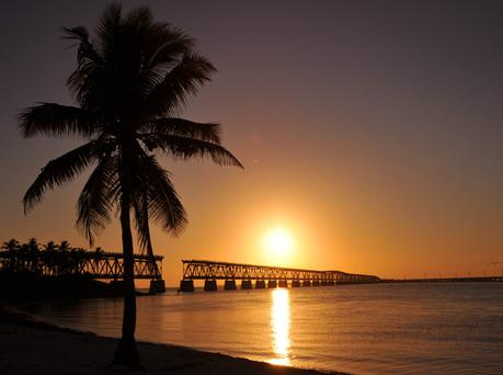 The sun sets behind the old railway bridge in the Bahia Honda State Park in Bahia Honda Key, Florida