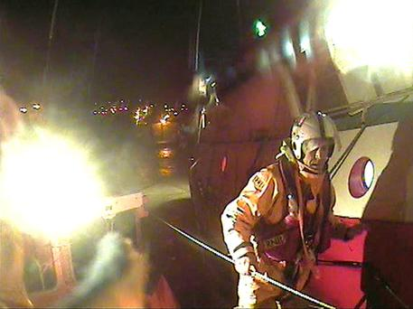 Wicklow RNLI rescuing four fishermen on a French-registered trawler after their vessel got into difficulty on the Irish Sea