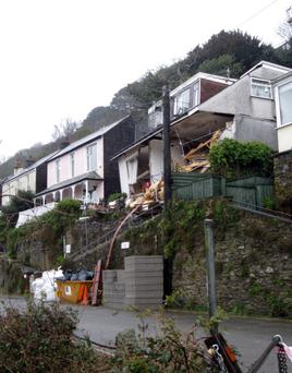 The collapsed 'Veronica' flats on Sandplace Road, East Looe, Cornwall, where one of the occupants is unaccounted for.