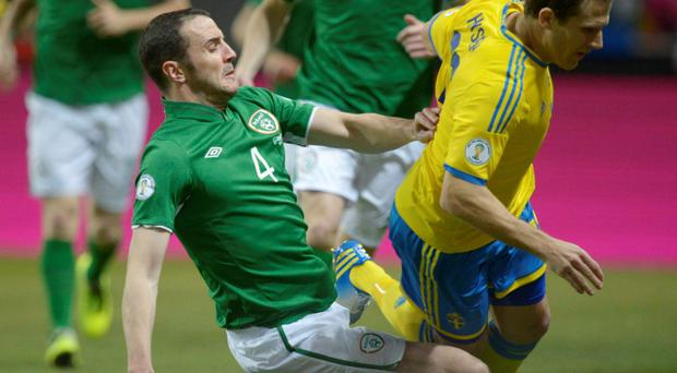 Ireland's John O'Shea fights for the ball with Sweden's Tobias Hysen. Photo: Reuters