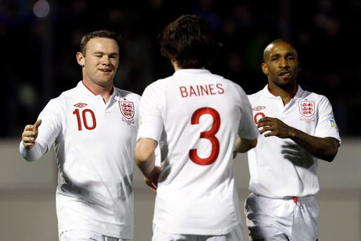 Wayne Rooney, Leighton Baines and Jermain Defoe of England celebrate after San Marino scored an own goal. Photo: Reuters