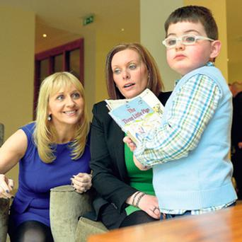 Liam Heffernan (right), with Miriam O'Callaghan (left) and his mum Mary.