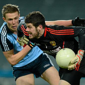 Down's Brendan McVeigh shields the ball from Paul Mannion during the Allianz Football League match in Croke Park.