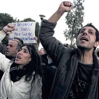 ANGER: Protesters on the streets of Nicosia, Cyprus