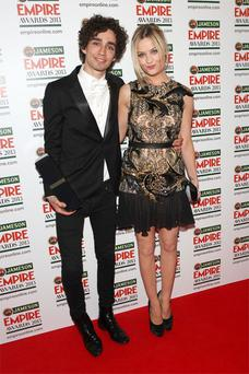 'Love/Hate' actor Robert Sheehan, who plays gangster Darren in the crime drama, and Irish TV presenter Laura Whitmore arm-in-arm on the red carpet as they arrived for the Jameson Empire Film Awards at Grosvenor House Hotel in London