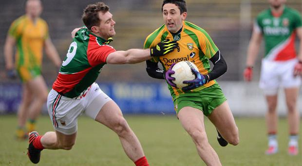 Rory Kavanagh attempts to get away from Mayo's Seamus O'Shea during their Allianz NFL Division 1 clash in Castlebar