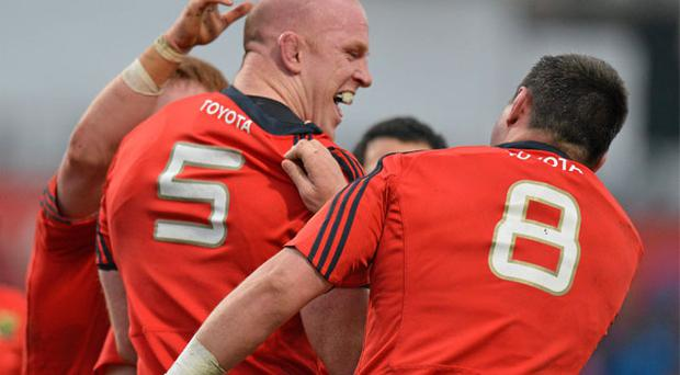 Paul O'Connell is congratulated by James Coughlan (right) and his Munster team-mates after scoring his try against Connacht