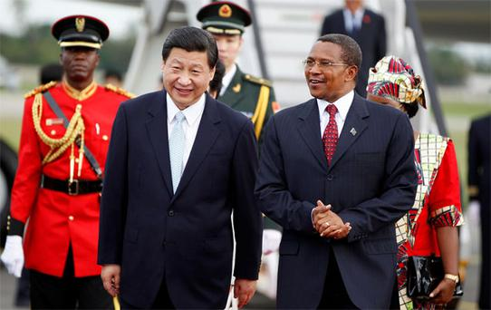 China's President Xi Jinping (front left) with his Tanzanian counterpart Jakaya Kikwete, on Mr Xi's arrival at Julius Nyerere International Airport in Dar es Salaam yesterday