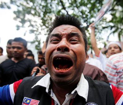 A Myanmar Muslim living in Malaysia shouts slogans during a demonstration against the killings of Muslims in Meikhtila, in Kuala Lumpur March 25, 2013.
