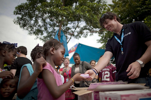 Rory McIlroy distributes aid to children in Port-au-Prince in June 2011