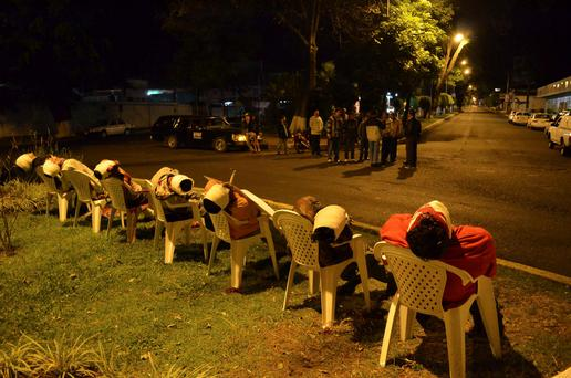 The bodies of seven men arranged in chairs are pictured in Uruapan, in the Mexican state of Michoacan
