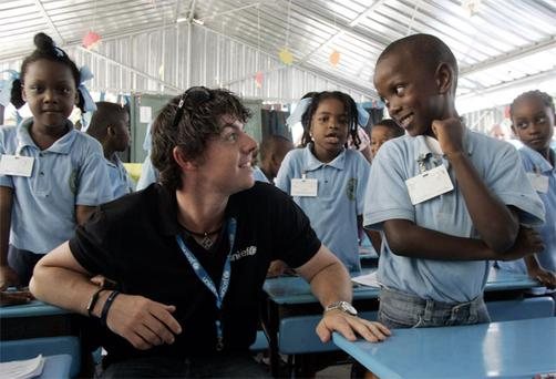 Rory McIlroy with Haitian children on his first trip to Haiti in June, 2011, as UNICEF Ireland Ambassador