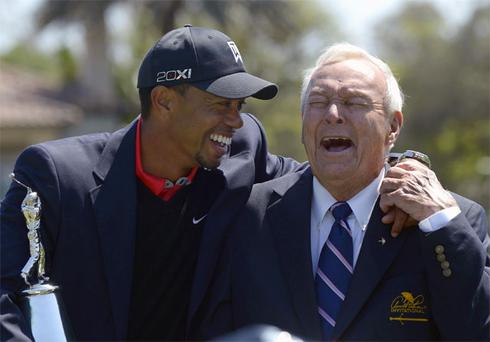 Tiger Woods shares a joke with Arnold Palmer after regaining the World's number one position at Bay Hill yesterday