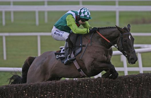 Ruby Walsh jumps the final fence on Denman to win the Lexus Chase at Leopardstown race course