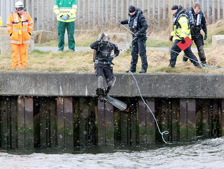 Gardai divers search the waters at the scene on South Quay in Arklow