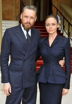 Stella McCartney arrives at Buckingham Palace in central London, with husband Alasdhair Willis