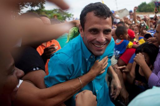 Venezuela's opposition candidate Henrique Capriles greets supporters during a campaign rally