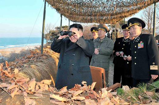 North Korean leader Kim Jong-Un watches soldiers of the Korean People's Army (KPA) taking part in landing and anti-landing drills in the eastern sector of the front and the east coastal area