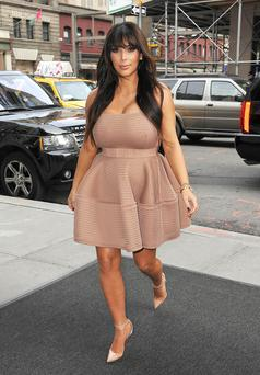 Kim began her trio of ensembles by opting for a blush-hued flared skirt and matching lace-accented top