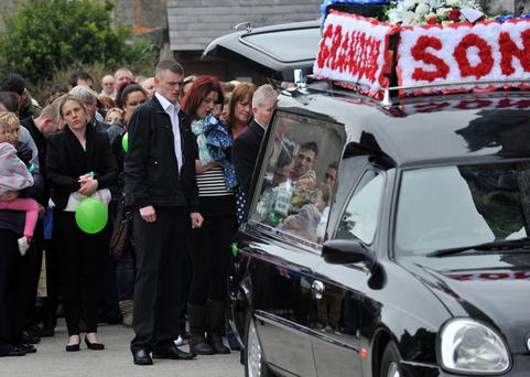 Father Paul Butler and mother Edel Casey pictured at the funeral of drowning victim James Casey Butler in Midleton, Co Cork. Photo: Provision