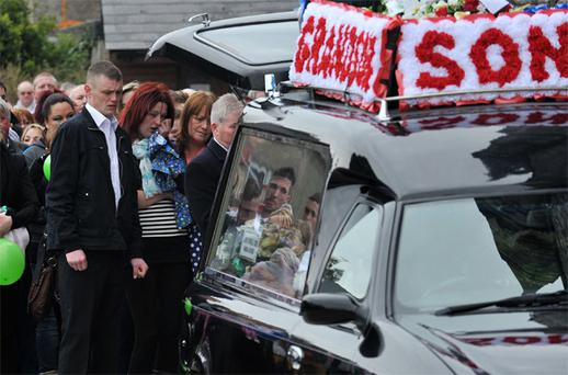 Father Paul Butler and mother Edel Casey at the funeral of drowning victim James Casey-Butler in Midleton, Co Cork