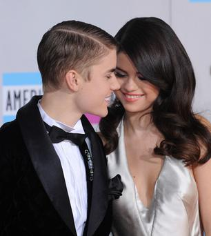 In better times: Justin Bieber and Selena Gomez arrive at the 2011 American Music Awards (Photo by C Flanigan/FilmMagic)