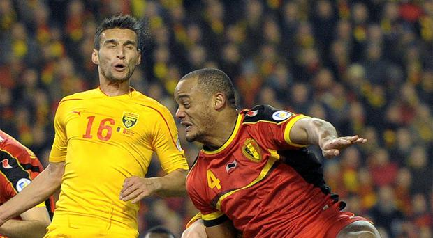 Vincent Kompany, right, in the thick of the action for Belgium against Macedonia