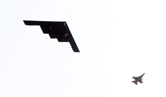 A U.S. air force B-2 Spirit stealth bomber (L) flies over Pyeongtaek, south of Seoul today