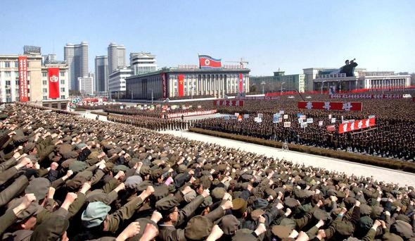 North Koreans including soldiers attend a rally in support of North Korean leader Kim Jong-un's order to put its missile units on standby.
