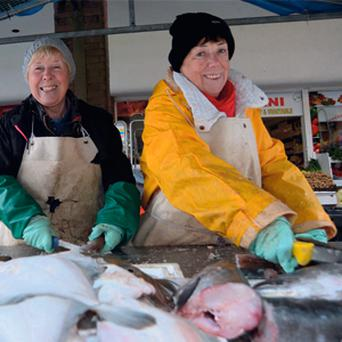 Sisters Margaret, left, and Imelda Buckley at their fish stall on Dublin's Moore Street.