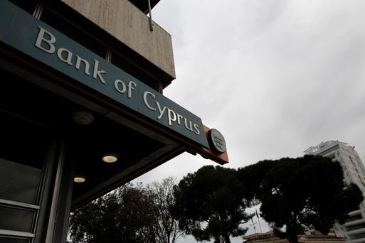 The logo of the Bank of Cyprus is seen outside one of its branches at Eleftheria square