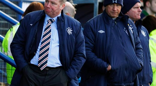 Rangers manager Ally McCoist (L) stands in the dugout area during their Scottish Third Division match