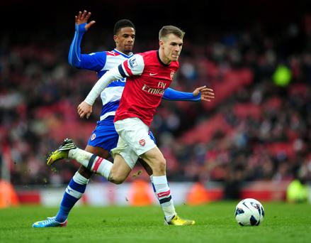 Arsenal's Aaron Ramsey gets away from Reading's Garath McCleary (left)