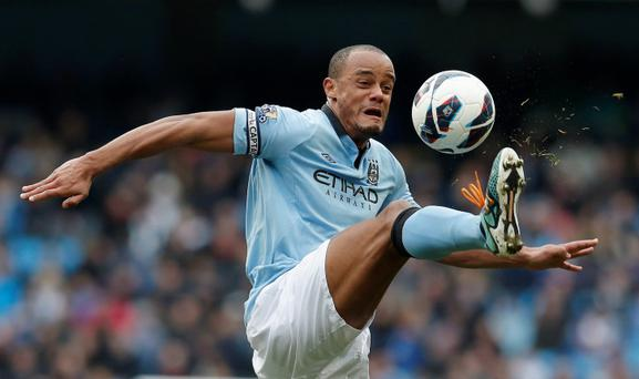 Manchester City's Vincent Kompany stretches for the ball