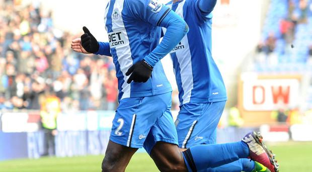 Wigan Athletic's Arouna Kone (left) celebrates scoring against Norwich City with James McCarthy