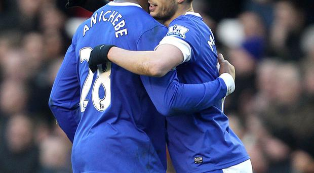 Everton's Kevin Mirallas (right) celebrates with his team-mate Victor Anichebe (left) after scoring his team's opening goal