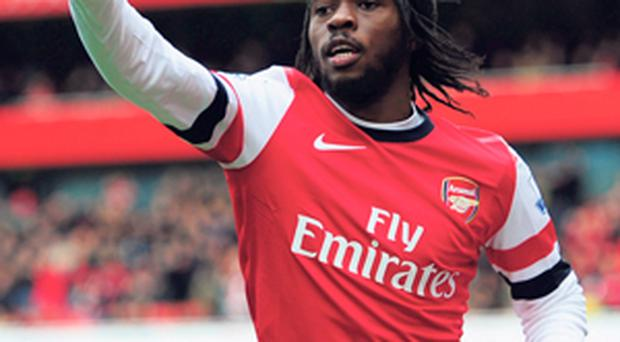 Gervinho of Arsenal celebrates scoring his side's first goal against Reading during their Premier League clash at the Emirates yesterday
