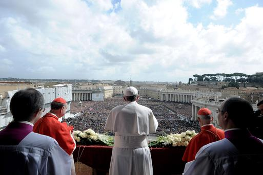 Pope Francis delivers the Urbi et Orbi (to the city and to the world) blessing, in St. Peter's Square at the Vatican, Sunday, March 31, 2013.