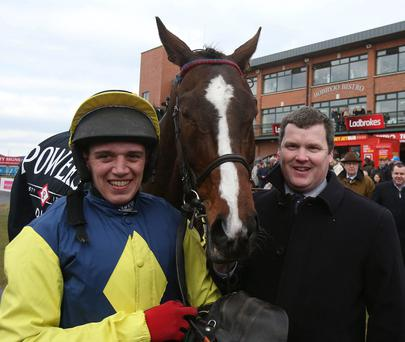 Realt Mor with Jockey Davey Condon and trainer Gordon Elliott after winning the Powers Gold Cup during the Easter Festival at Fairyhouse Racecourse