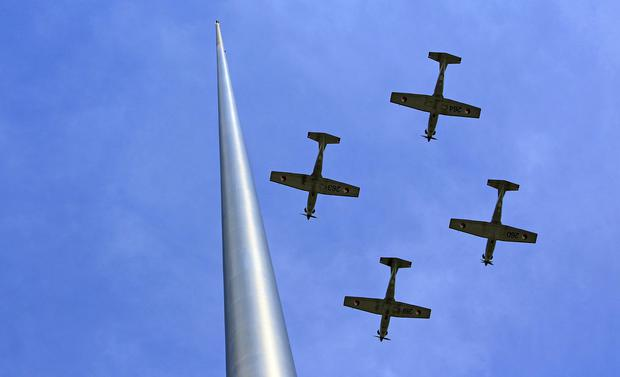 Aircraft from the Irish Defence Forces fly past the Spire on O'Connell Street, Dublin, during the 97th anniversary of the 1916 Easter Rising