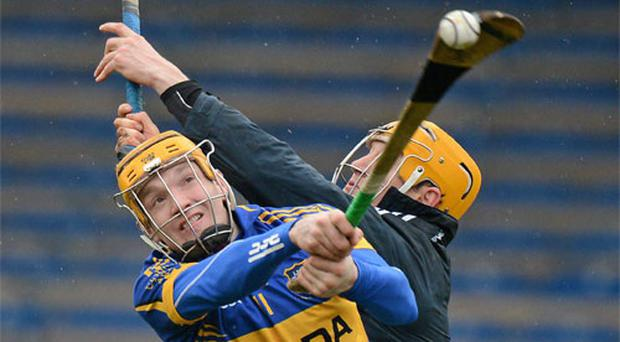 Tipperary's Lar Corbett scores his side's second goal despite the efforts of Clare goalkeeper Patrick Kelly