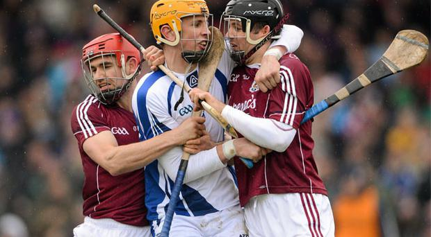 Waterford's Maurice Shanahan gets squeezed out between Galway's Fergal Moore, left, and David Collins during their NHL Division 1A clash in Walsh Park