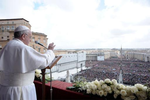 Pope Francis waves during his 'Urbi et Orbi' (To the City and the World) address in St Peter's Square