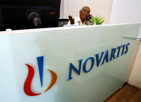A man speaks on a telephone inside Novartis India headquarters in Mumbai