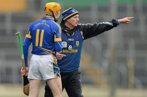Eamon O'Shea, issuing instructions to Lar Corbett on Sunday, wants change to the league format despite finishing top of the pile